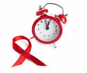 Aids awareness red ribbon and clock