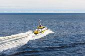Yellow Boat Speeding Away