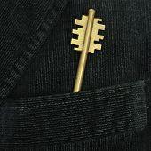 Golden Metal Key In A Pocket Of Male Suit
