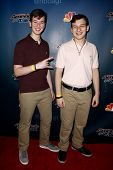 NEW YORK-AUG 13: Musicians Emil (L) and Dariel Rubanchik attend the post-show red carpet for NBC's 'America's Got Talent' Season 9 at Radio City Music Hall on August 13, 2014 in New York City.