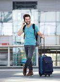 Male Traveler Talking On Mobile Phone