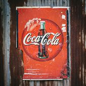Chiang Mai,thailand -aug 23: Old Rust Condition Vintage Of Coca Cola Logo. On August 23, 2014