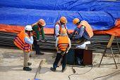 Asia Construction Worker Working On Vietnam Site