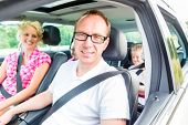 picture of seatbelt  - Family driving in car with seat belt fastened - JPG