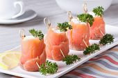 Rolls Of Salmon With Cream Cheese Close-up Horizontal