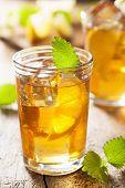 glass of ice tea with lemon and melissa