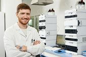 researcher man at scientific analysing work in chemistry laboratory
