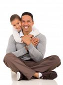 portrait of happy little girl hugging her father