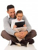 happy father with his little girl using tablet computer on white background