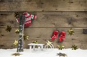 Christmas Wooden Background With A Skiing Concept For Traveling.