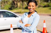 portrait of pretty african student driver in testing ground