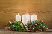Colorful Advent Wreath With Four White Burning Candles.