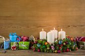 Christmas Presents And Advent Wreath On Wooden Colorful Background.