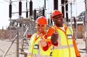 picture of substation  - two cheerful technicians giving thumbs up in substation - JPG