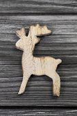 Wooden Reindeer Figure On Grey Background For Christmas.
