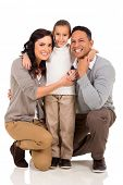 pretty little girl with her parents isolated on white background