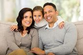 portrait of pretty little girl with her parents at home