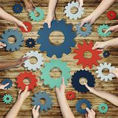 Group of Hands Holding Gears Symbol