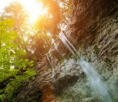 Waterfall in a forest in Slovak Paradise, Slovakia