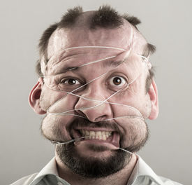 picture of ugly  - Ugly man tied with strings on his face - JPG