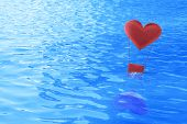 Fabric red heart air balloon float on sea, love concept