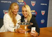 US Open 2014 women doubles champions Ekaterina Makarova and Elena Vesnina taking selfie with trophy