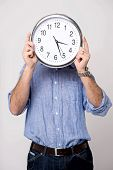 Man Holding Clock, Show Time To You.