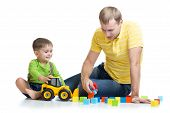 kid and his dad repair toy tractor