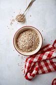 Organic rye flakes in a bowl