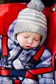 Baby Boy Sleeping In The Stroller