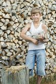 Portrait of teenager at firewood stack background