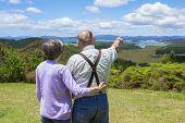 Senior Couple on vacation looking at beautiful ocean views