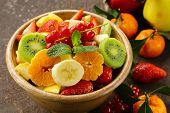 Fresh organic fruit salad (kiwi, strawberry, banana, currant, apple)