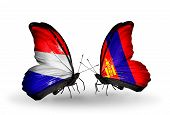 stock photo of holland flag  - Two butterflies with flags on wings as symbol of relations Holland and Mongolia - JPG