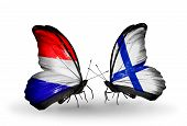 foto of holland flag  - Two butterflies with flags on wings as symbol of relations Holland and Finland - JPG