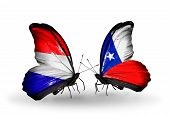 stock photo of holland flag  - Two butterflies with flags on wings as symbol of relations Holland and Chile - JPG