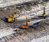 stock photo of open-pit mine  - pit iron ore mining and transport winter season - JPG
