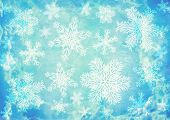 Christmas background of blue color with snowflakes