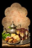Display of oriental cookies and iftar dates on a Moroccan tea tray