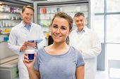 Happy customer holding her medicine at the hospital pharmacy