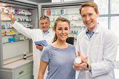 Happy customer talking with pharmacist at the hospital pharmacy
