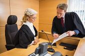 foto of court room  - Lawyer speaking with the judge in the court room - JPG