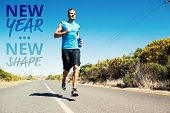 Athletic man jogging on open road holding bottle against new year new shape