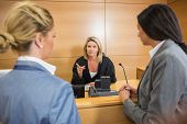 stock photo of court room  - Lawyers speaking with the judge in the court room - JPG