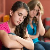 Teenage problems - Sad teenage girl and her worried mother