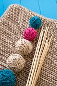 Colorful Balls And Wooden Needles Lying On Beige