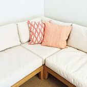 White Corner Sofa With Pink Cushions