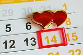 Date February 14 marked on the calendar. Two hearts the concept of love.