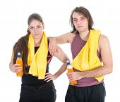Man And Woman In Sports Wear Relaxing With Orange Juice, Isolated Over White