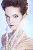 Beauty fashion woman over blue background. Winter beauty woman. Snow queen. Make-up